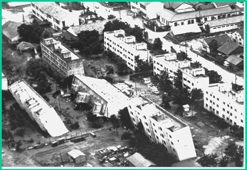 USGS picture of a tilted building from soil liquefaction after a 1964 earthquake in Niigata, Japan